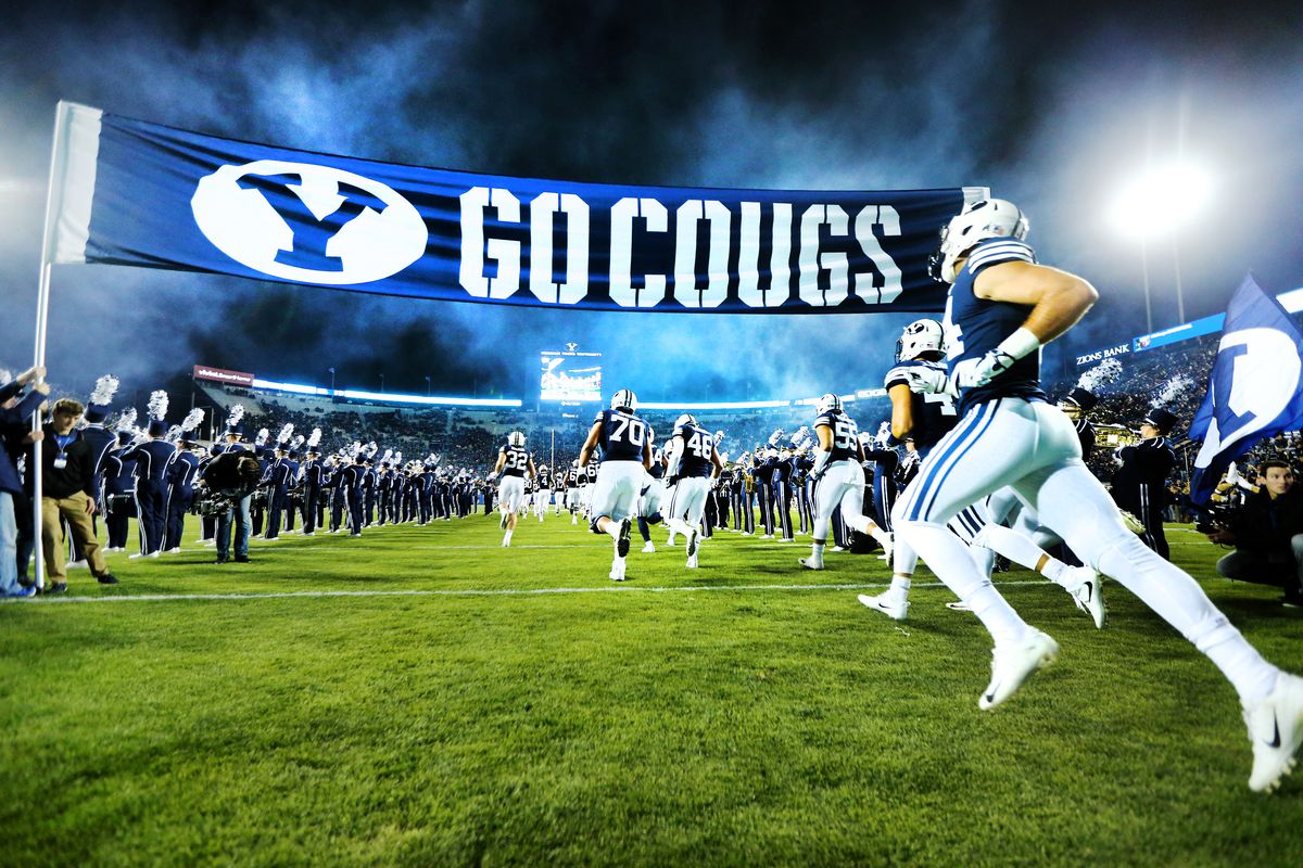BYU players run onto the field as they and Hawaii prepare to play at LaVell Edwards Stadium in Provo on Oct. 13, 2018.