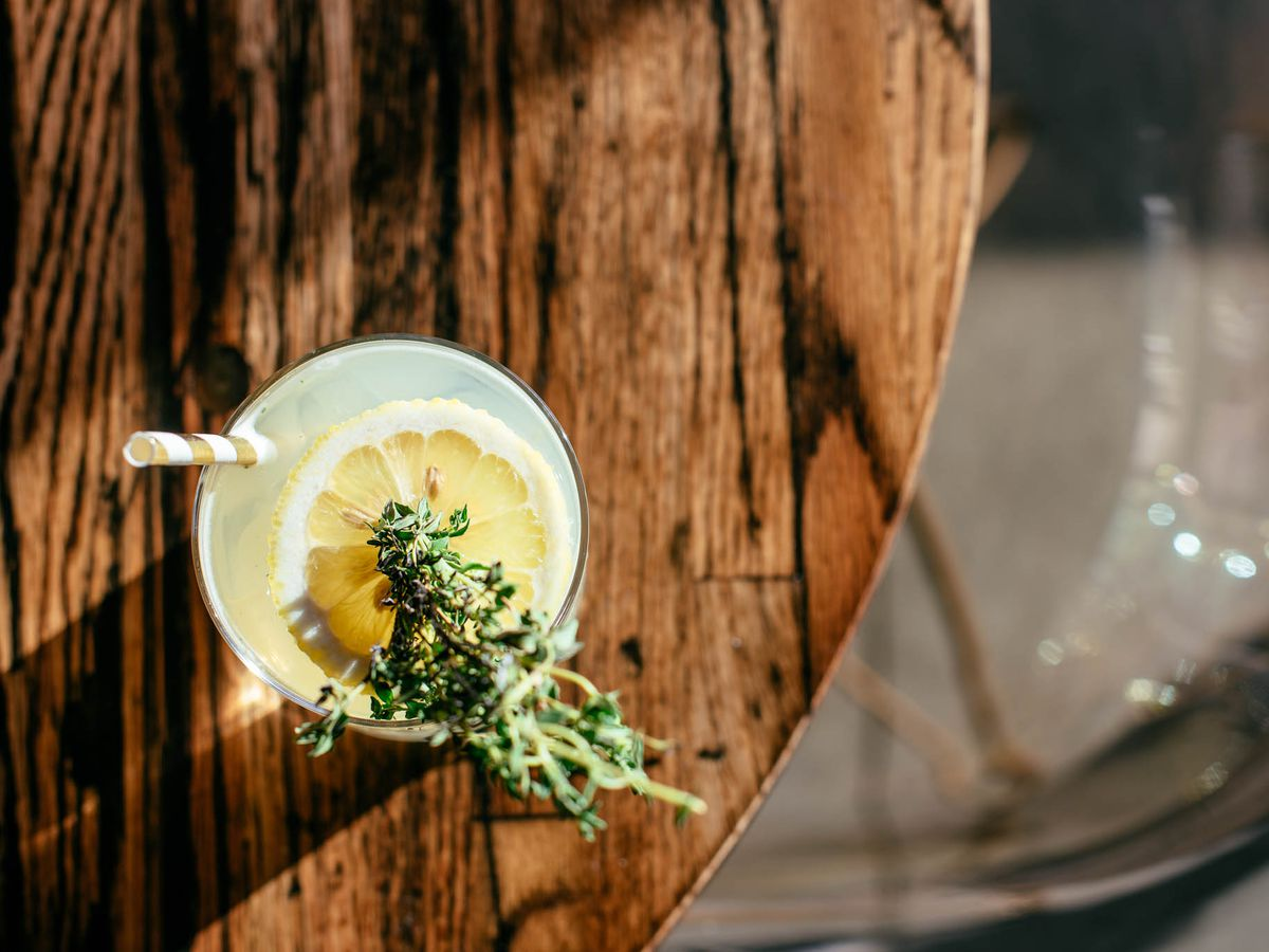 """<span data-author=""""7916"""">Bar Helix cocktail with herb and citrus garnish</span>"""