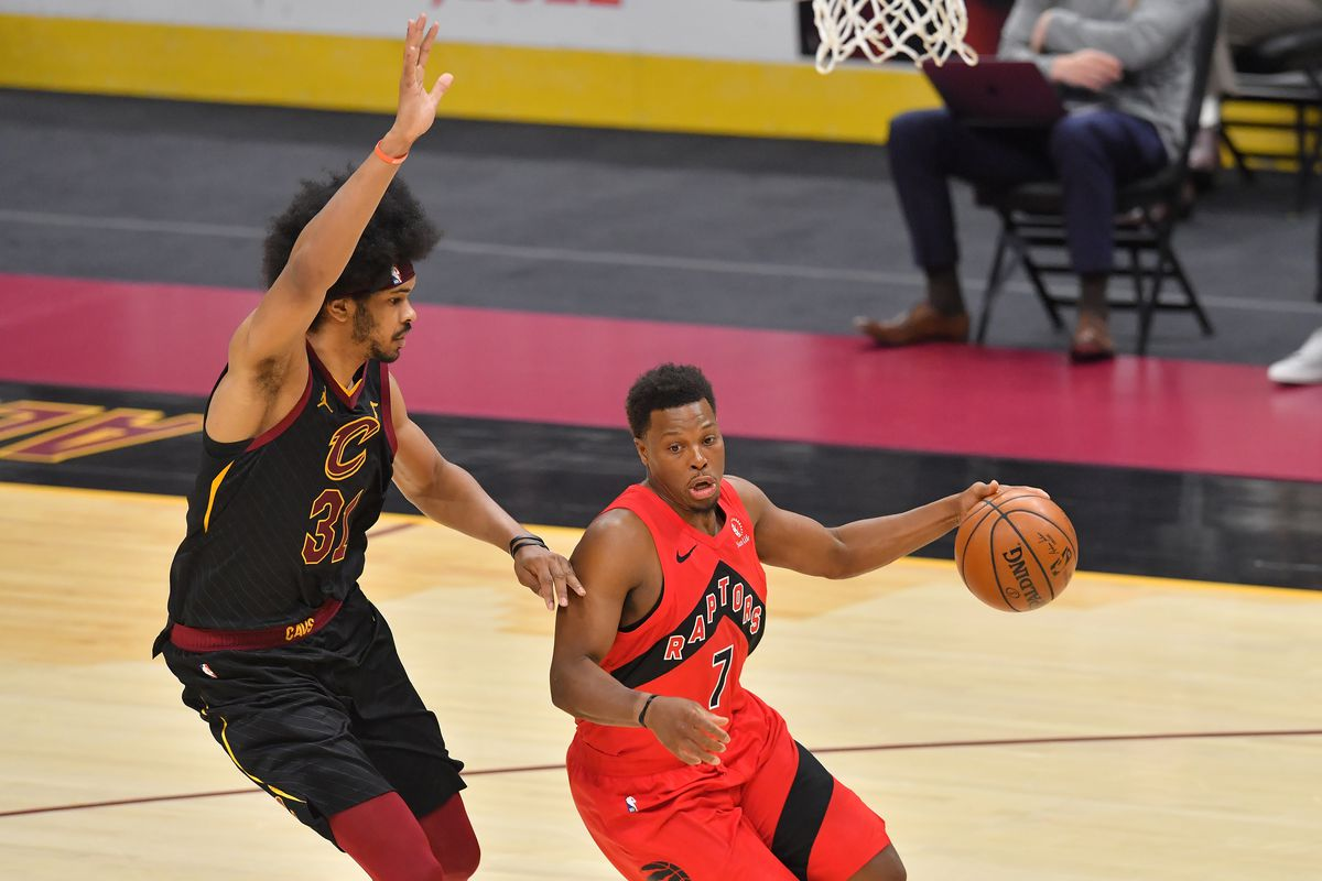Kyle Lowry of the Toronto Raptors drives around Jarrett Allen of the Cleveland Cavaliers during the third quarter at Rocket Mortgage Fieldhouse on March 21, 2021 in Cleveland, Ohio.