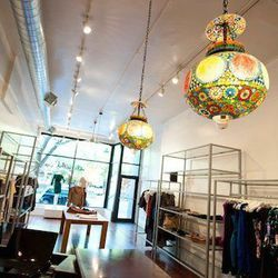 """""""Our new home is dangerously close to <a href=""""handlewithcareboutique.com"""">Handle with Care</a> [1706 North Wells Street] so we're always tempted to pop in and check out a sale or look for a Saturday night outfit,"""" Julia says. """"We never walk out empty-han"""