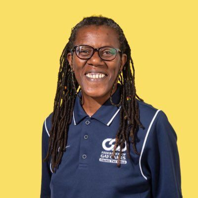 Co-President of the Gay Games Joanie Evans smiles for the camera in her Twitter profile picture.