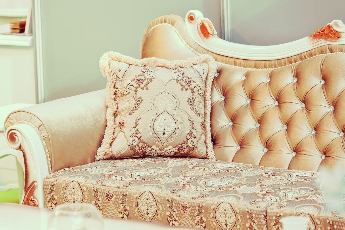 A Champagne Colored Couch In French Design