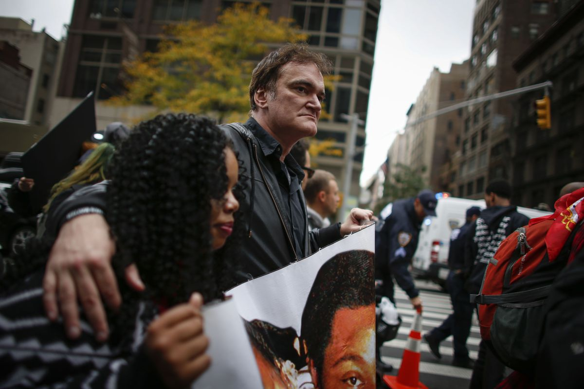 Filmmaker Quentin Tarantino marches in a rally protesting police brutality on October 24, 2015.