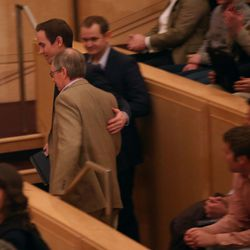 A man is escorted out after heckling Mitt Romney, former governor of Massachusetts, as he addressed the Hinckley Institute of Politics regarding the state of the 2016 presidential race. The speech took place at the University of Utah in Salt Lake City on Thursday, March 3, 2016.