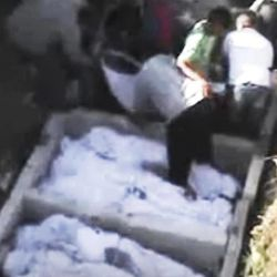 This image made from amateur video released by the Shaam News Network and accessed Monday, April 23, 2012, purports to show covered bodies before a funeral in Hama, Syria. Rebels seeking to topple Syrian President Bashar Assad's regime launched three separate attacks on his security forces around Damascus on Tuesday, killing two ranking officers and rocking the capital with a booby-trapped car, activists and state media said.