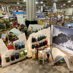 People attend the Outdoor Retailer Summer Market at the Salt Palace Convention Center in Salt Lake City on Wednesday, Aug. 3, 2016.