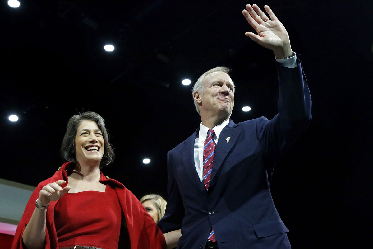 Bruce Rauner and his wife, Diana, wave to a crowd of supporters after he took the oath of office in Springfield as Illinois' 42nd governor.   Seth Perlman/AP