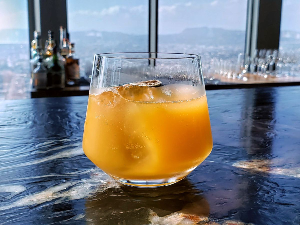 A cocktail sits on the bar at 71 Above