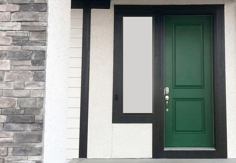 Deep green exterior door.