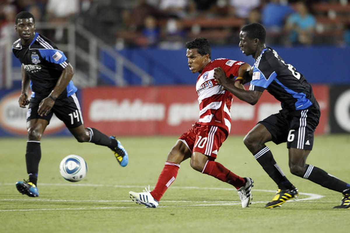 FRISCO, TX - JUNE 5: David Ferreira #10 of FC Dallas passes the ball between Brandon McDonald #14 and Ike Opara of the San Jose Earthquake at Pizza Hut Park on June 5, 2010 in Frisco, Texas. FC Dallas won 2-0. (Photo by Layne Murdoch/Getty Images)