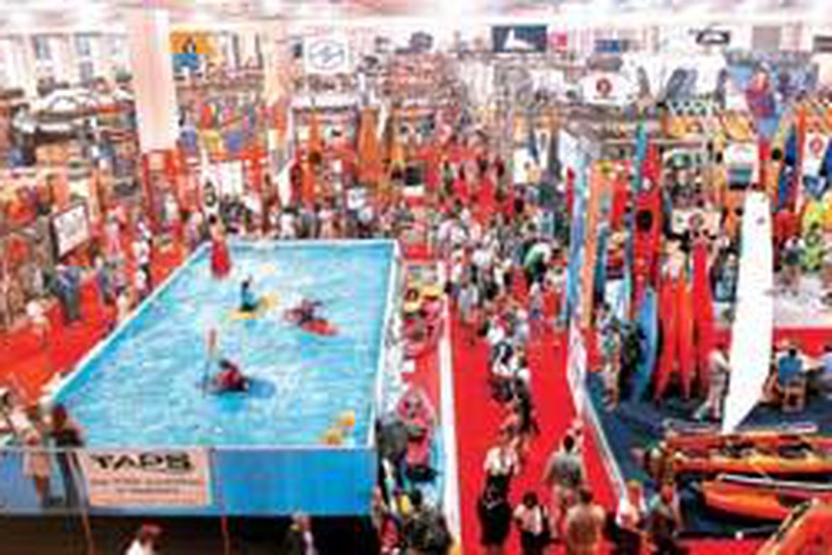 Vendors from the Outdoor Retailer trade show 2004 fill the showroom floor of the Salt Palace Convention Center. The show will be back next year, and the Salt Lake Convention and Visitors Bureau is planning to attract more business and leisure travelers to