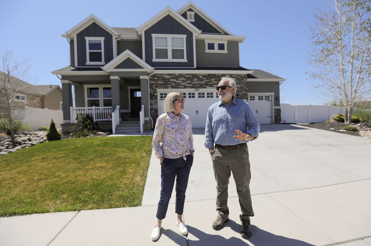 Michelle and Steve Allen pose for a portrait outside of their home in Heber City on Thursday, May 6, 2021.