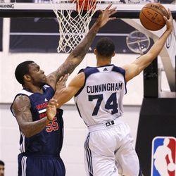 Utah Jazz's Jared Cunningham shoots over Washington Wizards' Shawn Jones during the first half of their NBA summer league basketball game Wednesday, July 15, 2015, in Las Vegas. (AP Photo/John Locher)