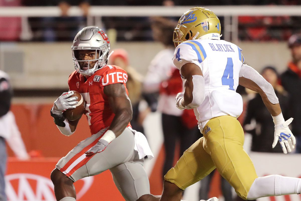 Utah Utes running back Devonta'e Henry-Cole (7) looks over his shoulder as he runs ahead of UCLA Bruins defensive back Stephan Blaylock (4) on his way in for a touchdown as Utah and UCLA play a college football game in Salt Lake City at Rice-Eccles Stadium on Saturday, Nov. 16, 2019. Utah won 49-3.