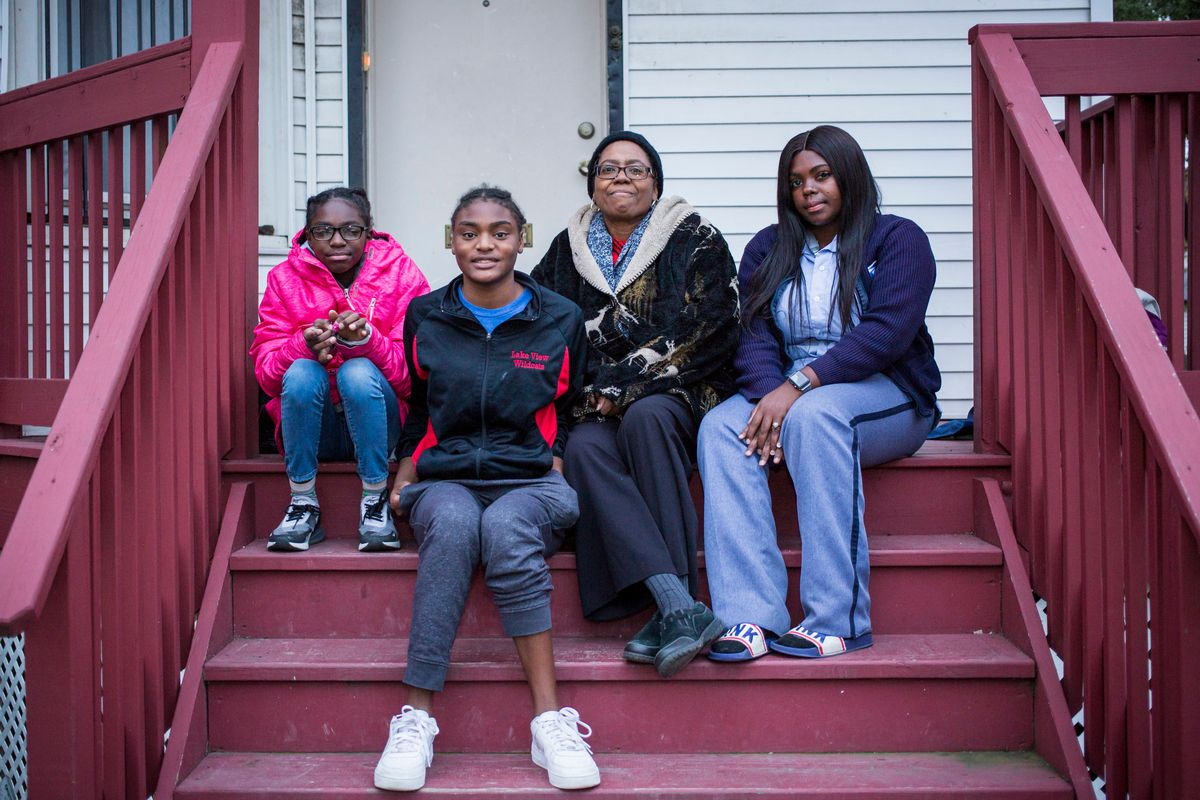 Rolinda Robinson (center), with her daughters Brijah, 12, Ladeja, 16, and Walkeisha, 25, in front of their West Side home | James Foster/For the Sun-Times