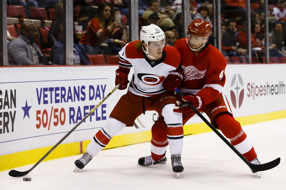 Brock McGinn had a memorable first NHL, scoring on his first shift and adding an assist to help lead Carolina to its first win of the season, 5-2 over Detroit.