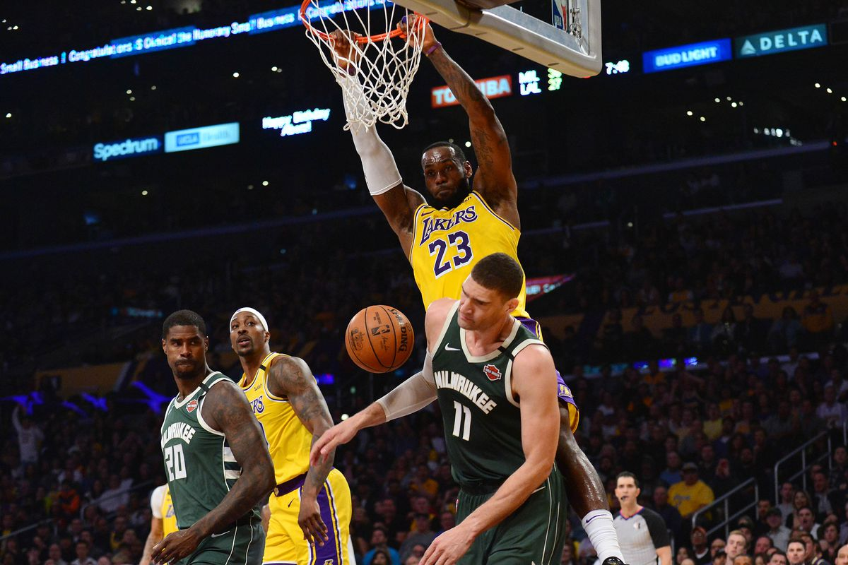Los Angeles Lakers forward LeBron James dunks for a basket against Milwaukee Bucks center Brook Lopez during the first half at Staples Center.