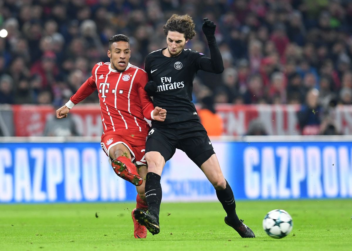 FBL-EUR-C1-BAYERN-PSG Bayern Munich's French midfielder Corentin Tolisso (L) and Paris Saint-Germain's French midfielder Adrien Rabiot (R) vie for the ball during the UEFA Champions League football match between Paris Saint-Germain and Bayern Munich, on December 5, 2017 in Munich, southern Germany. / AFP PHOTO / Christof STACHE