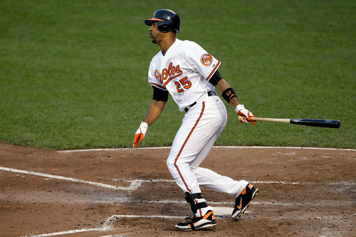 BALTIMORE, MD - JULY 16: Derrek Lee #25 of the Baltimore Orioles follows his RBI single against the Cleveland Indians during the fourth inning at Oriole Park at Camden Yards on July 16, 2011 in Baltimore, Maryland.  (Photo by Rob Carr/Getty Images)