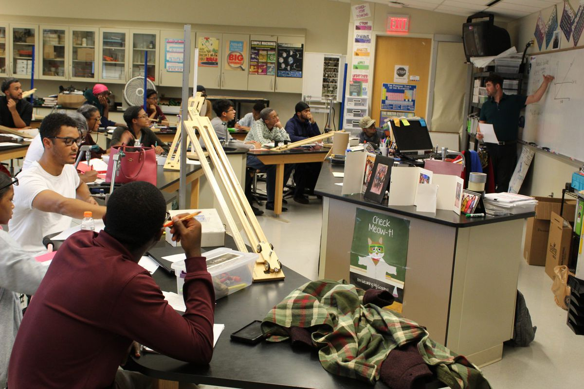 Adam Alster reviews velocity graphs with his 6th-hour AP Physics class at Renaissance High School.