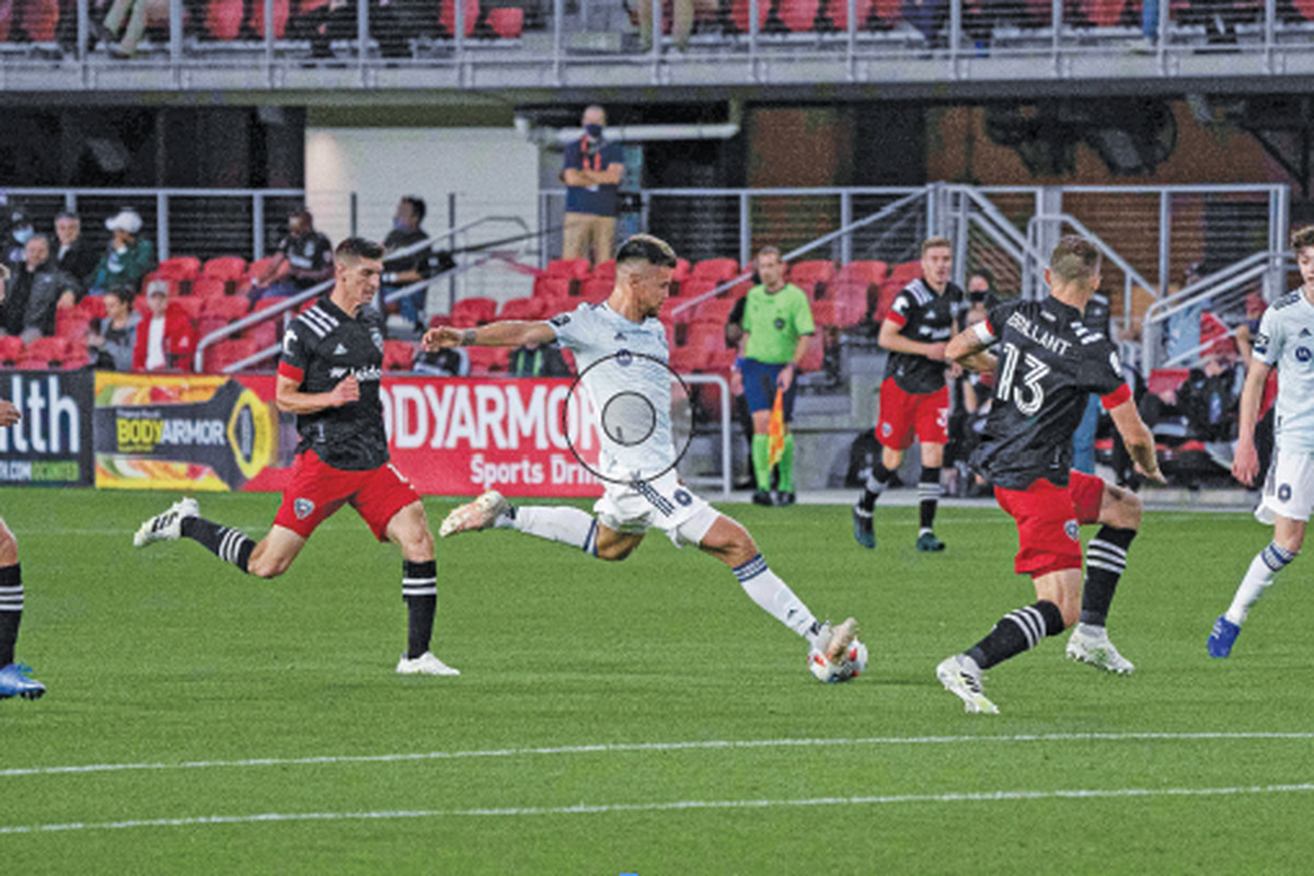 Fire midfielder Gaston Gimenez blasts a shot against D.C. United on Thursday night in Washington. The Fire were shut out for the third consecutive game.