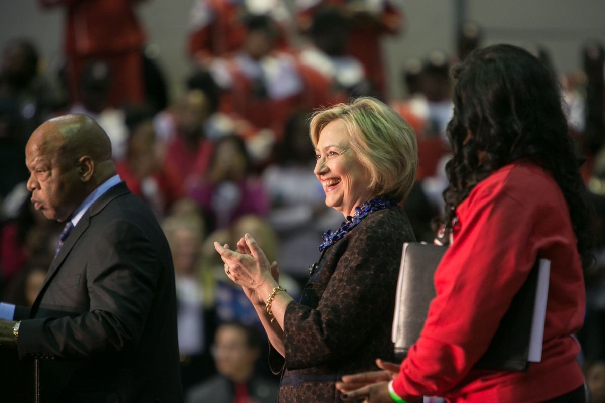 Democratic presidential candidate Hillary Clinton takes the stage with Rep. John Lewis (D-GA) (left) during an African Americans For Hillary rally at Clark Atlanta University on October 30, 2015, in Atlanta, Georgia.