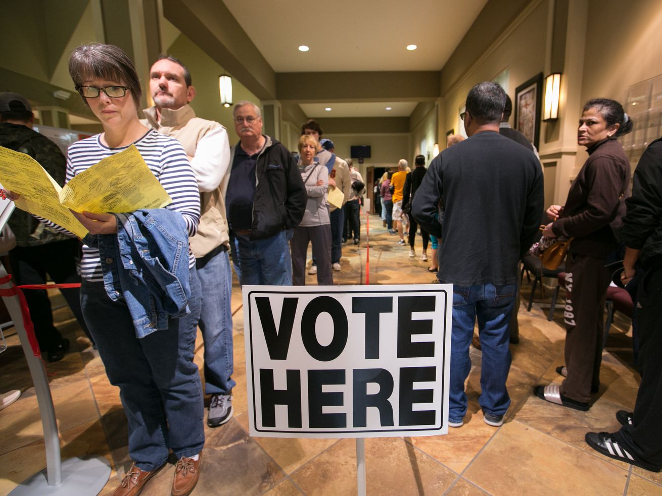 Voters line up to cast their ballots at a polling station set up at Noonday Baptist Church for the midterm elections on Nov. 6, 2018, in Marietta, Ga.