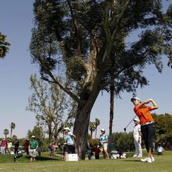 Haeji Kang, of Sourth Korea, watches her shot into the wind on the fifth hole during the third round of the LPGA Kraft Nabisco Championship golf tournament in Rancho Mirage, Calif., Saturday, March 31, 2012.