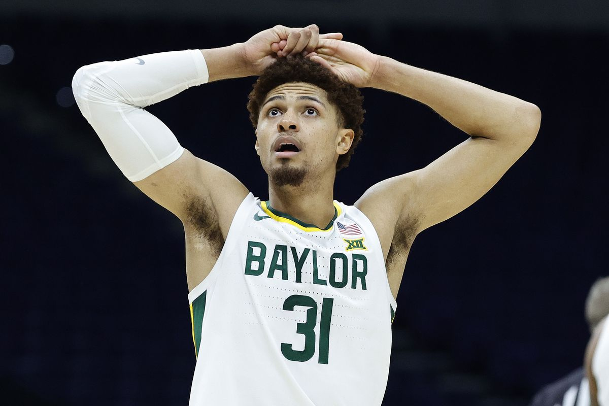 MaCio Teague of the Baylor Bears reacts against the Arkansas Razorbacks during the second half in the Elite Eight round of the 2021 NCAA Men's Basketball Tournament at Lucas Oil Stadium on March 29, 2021 in Indianapolis, Indiana.