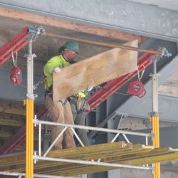 11:56 a.m. Board being removed from under the left-field bleachers -
