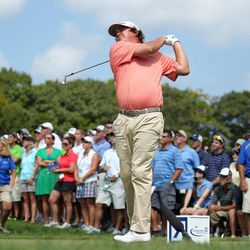 Jason Dufner hits his tee shot on the third hole during the second round of the Deutsche Bank Championship PGA golf tournament at TPC Boston in Norton, Mass., Saturday, Sept. 1, 2012.