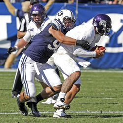 Brigham Young Cougars defensive lineman Bronson Kaufusi (90) sacks Weber State Wildcats quarterback Mike Hoke (11) as Brigham Young University defeats Weber State University in football 45-6 Saturday, Sept. 8, 2012, in Provo, Utah.