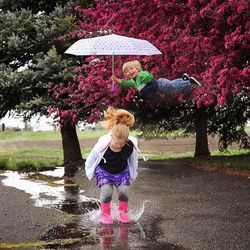"""Ali and William Lawrence play in the rain. Alan Lawrence photographed his son William in a series titled """"Wil Can Fly"""" on his blog, <a href=""""http://thatdadblog.com/"""">thatdadblog.com</a>"""