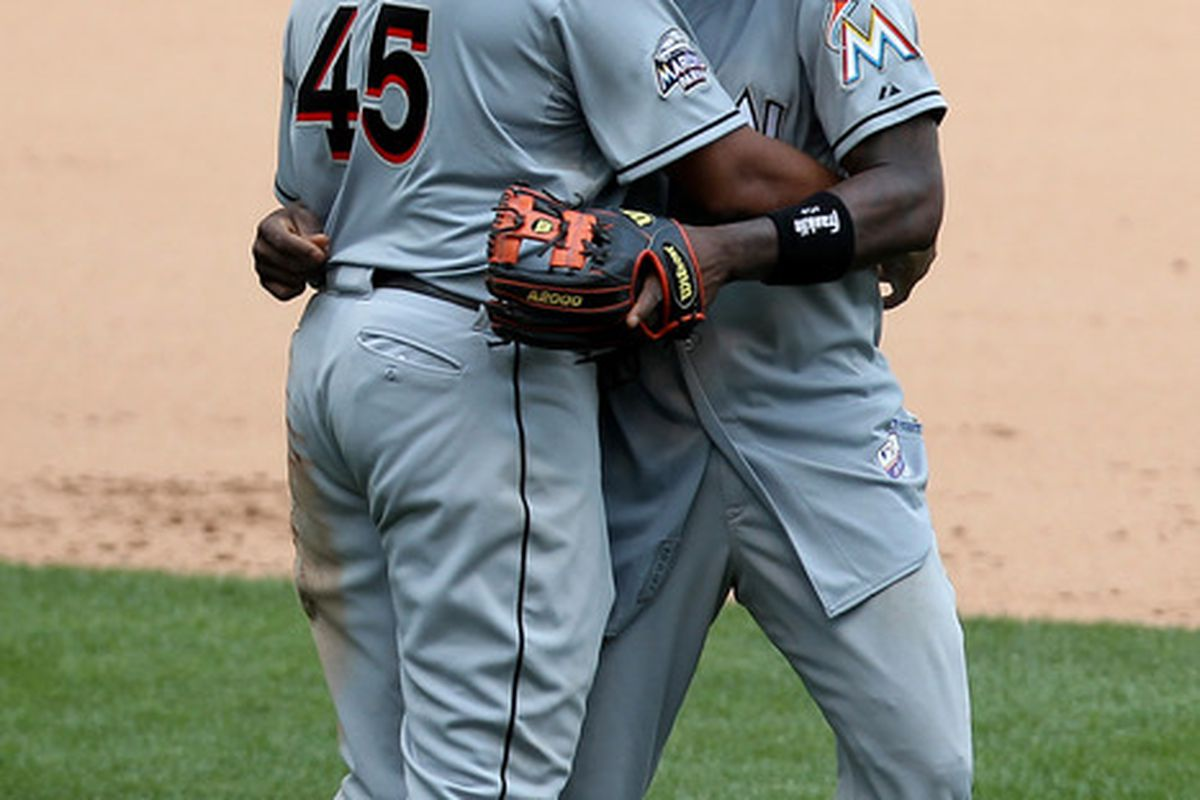 MILWAUKEE, WI - JULY 05: Hanley Ramirez #2 of the Miami Marlins hugs Carlos Lee #45 after the 4-0 win against Milwaukee Brewers at Miller Park on July 05, 2012 in Milwaukee, Wisconsin. (Photo by Mike McGinnis/Getty Images)