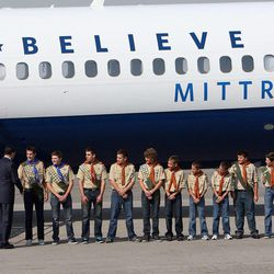 Mitt Romney greets Boy Scouts from Salt Lake City Troop 315 as he arrives in Salt Lake City, Tuesday, Sept. 18, 2012.