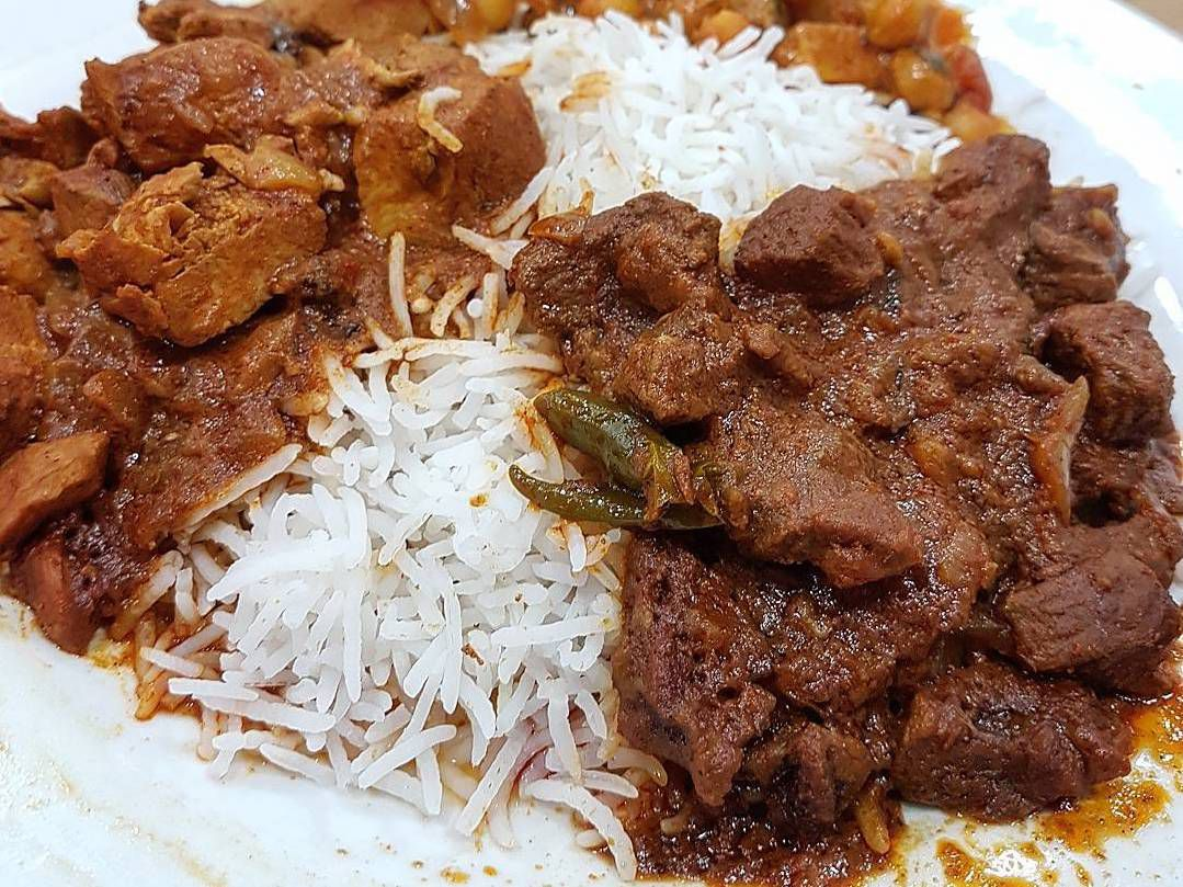 Lamb curry and chickpea curry with white rice at Everest Curry King, one of the best places to eat in Lewisham