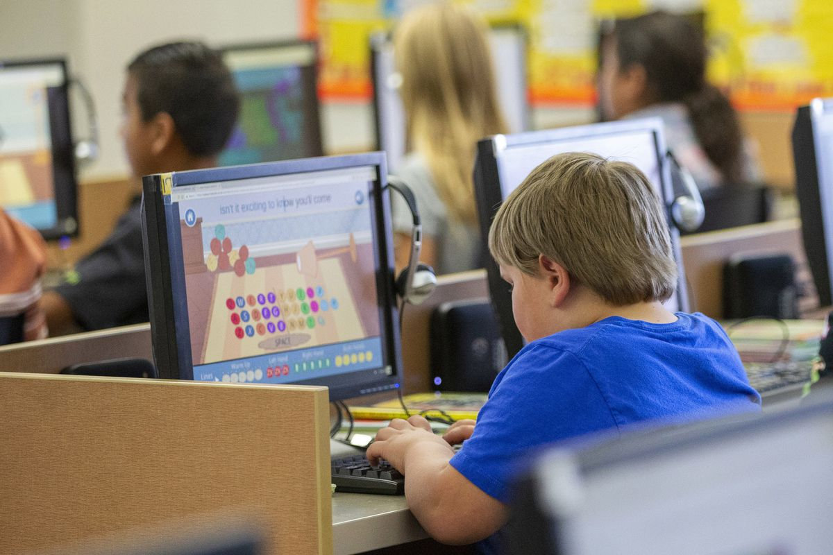 FILE - In this Oct. 29, 2018 file photo, students work on computers at an elementary school in Beaver, Utah. According to a study published on Tuesday, April 23, 2019, Americans are becoming increasingly sedentary, spending almost a third of their waking