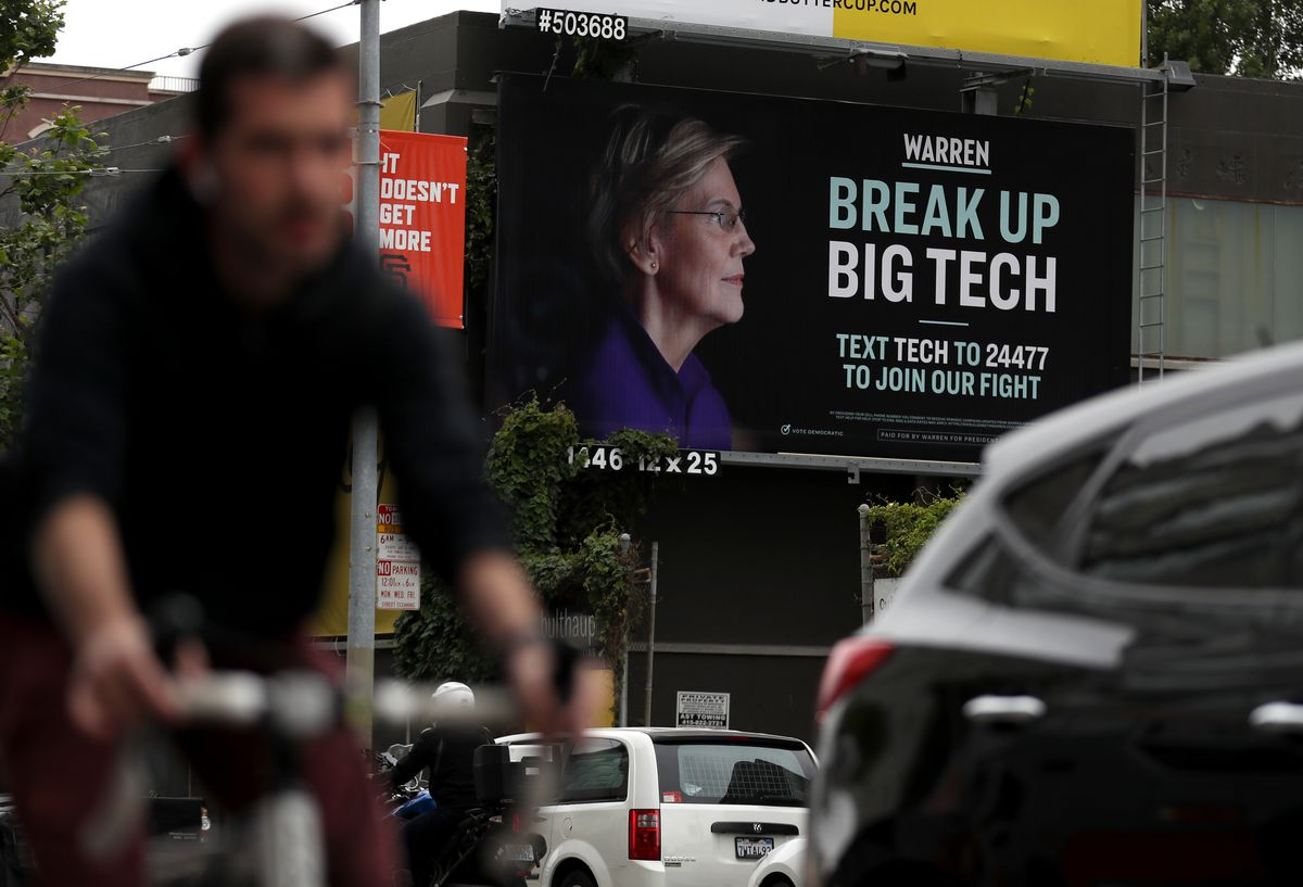 """Elizabeth Warren's campaign billboard in downtown San Francisco has a profile picture of the candidate and reads, """"Warren: Break up big tech. Text tech to 24477 to join our fight."""""""