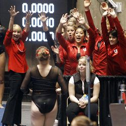 Co- Head Coach Megan Marsden, left, and the rest of the team cheer for Tory WIlson after her vault at the NCAA Salt Lake Regional Gymnastics Saturday, April 7, 2012 in Salt Lake City.