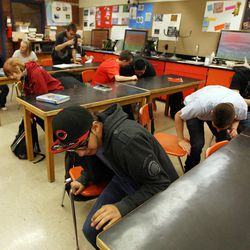 Taylorsville High School students in Steve Woolley's physics class crawl under their desks as they participate in an earthquake drill as part of The Great Utah ShakeOut, Tuesday, April 17, 2012. At front is Hetzael Soto.