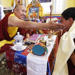 Tulku Choejor Rinpoche, left, accepts Kati as a member of the Tibetan Buddhist Temple participate in annual Prayers for Compassion celebrations in Salt Lake City Thursday, July 3, 2014. The three-day festival offers members of the Salt Lake community a chance to observe, support and participate in a beautiful around-the-clock ritual generating compassion and loving-kindness on behalf of all sentient beings.