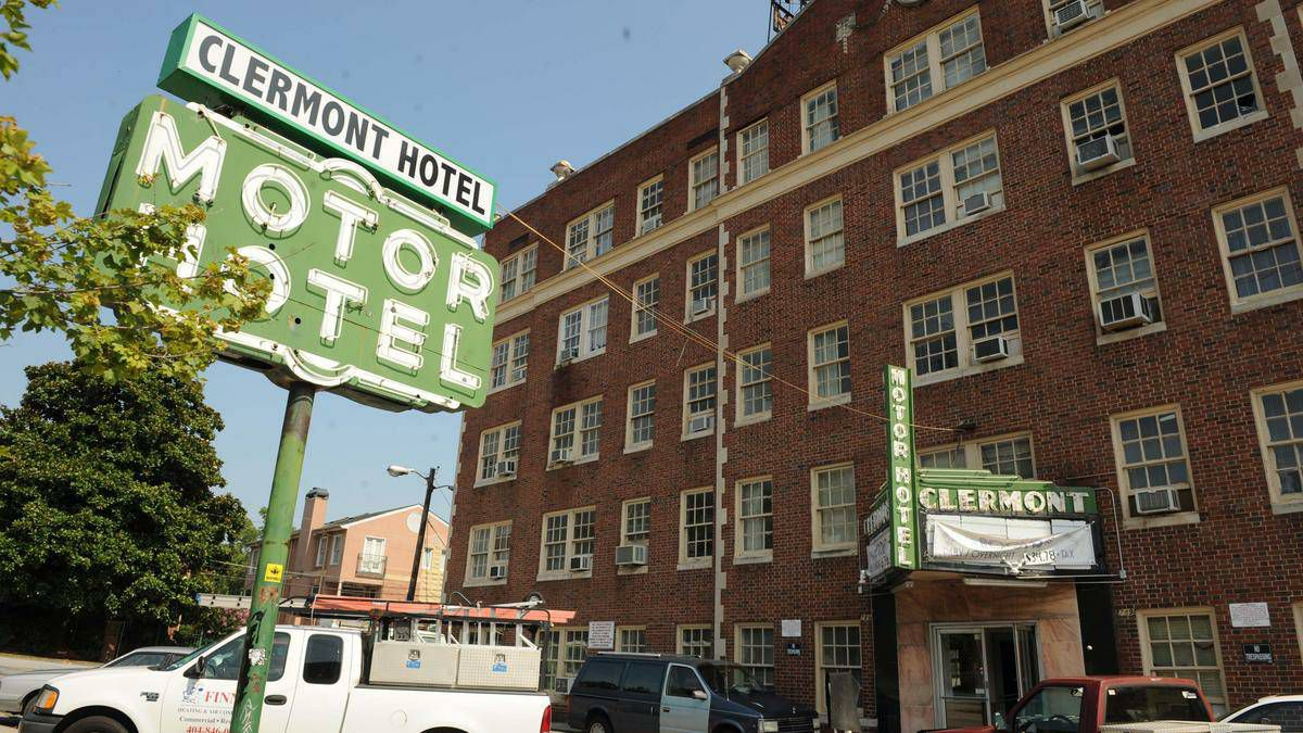 """A photo of the sign when it was still atop the """"MOTOR HOTEL"""" sign."""
