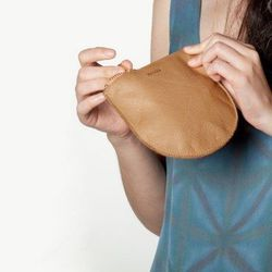 "BAGGU small leather <a href=""https://omoionline.com/shop/baggu-small-leather-zip-pouches/"">zip pouch</a>, $20 at Pine Street's Omoi Zakka Shop."