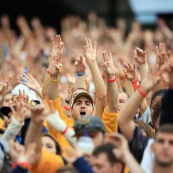 West Virginia fans cheer on their side during an NCAA college football game against Maryland in Morgantown, W.Va., Saturday, Sept. 22, 2012. WVU won 31-21.