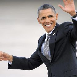 President Barack Obama waves to onlookers as he arrives at Buckley Air Force Base in Aurora, Colo., Tuesday, April 24, 2012.
