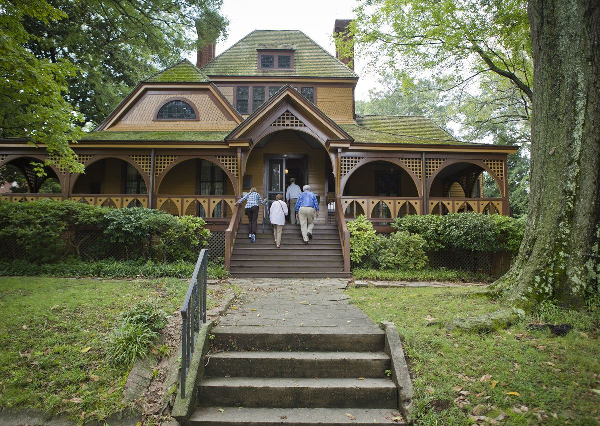 The exterior of the Wren's Nest in Atlanta. The facade is brown with a green roof and a porch.