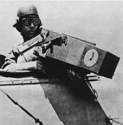W.L. Richardson pointing a camera from a plane.
