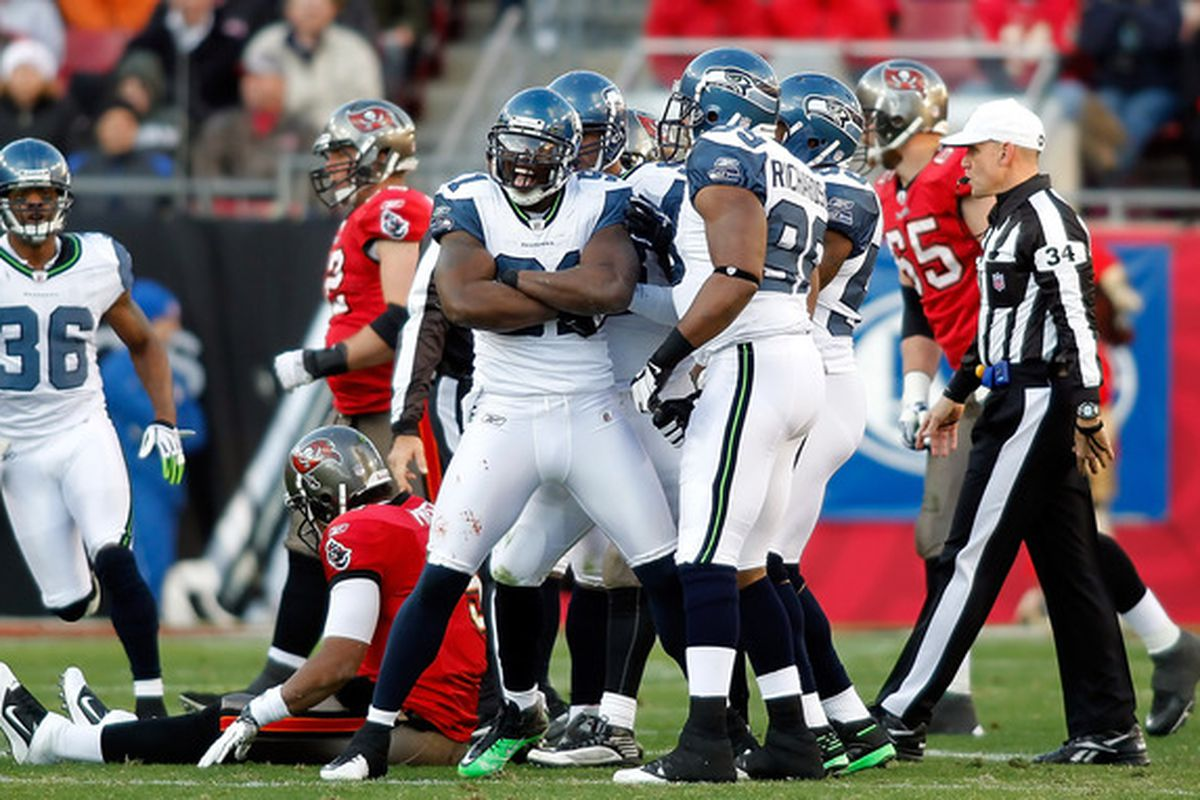 TAMPA FL - DECEMBER 26:  Defensive end Chris Clemons #91 of the Seattle Seahawks celebrates a sack against the Tampa Bay Buccaneers during the game at Raymond James Stadium on December 26 2010 in Tampa Florida.  (Photo by J. Meric/Getty Images)