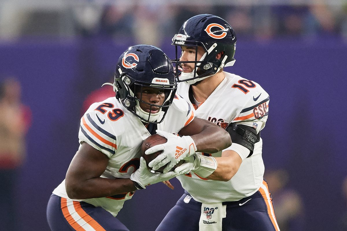 Mitchell Trubisky of the Chicago Bears hands the ball to teammate Tarik Cohen against the Minnesota Vikings during the game at U.S. Bank Stadium on December 29, 2019 in Minneapolis, Minnesota.