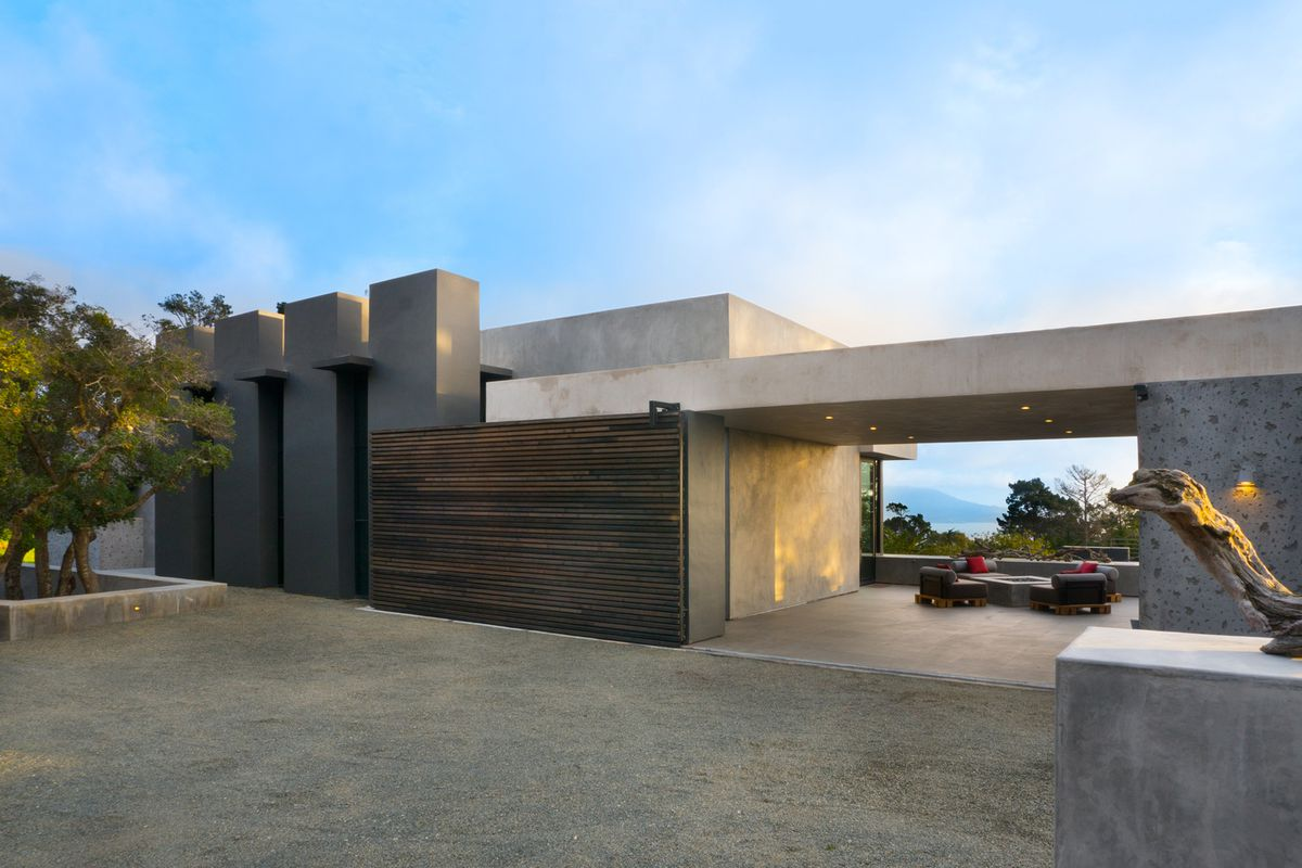 Concrete exterior of huge Pebble Beach house, very contemporary and modern.